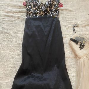 Strapless, black, sequenced front and on back.